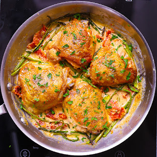 Chicken Thighs with Creamy Asparagus, Sun-Dried Tomato Sauce.