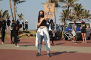 Protesters gathered on Durban's beachfront on Saturday to protest against gender-based violence