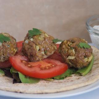 Middle Eastern Meatball Sandwich with Cucumber Yogurt Sauce.