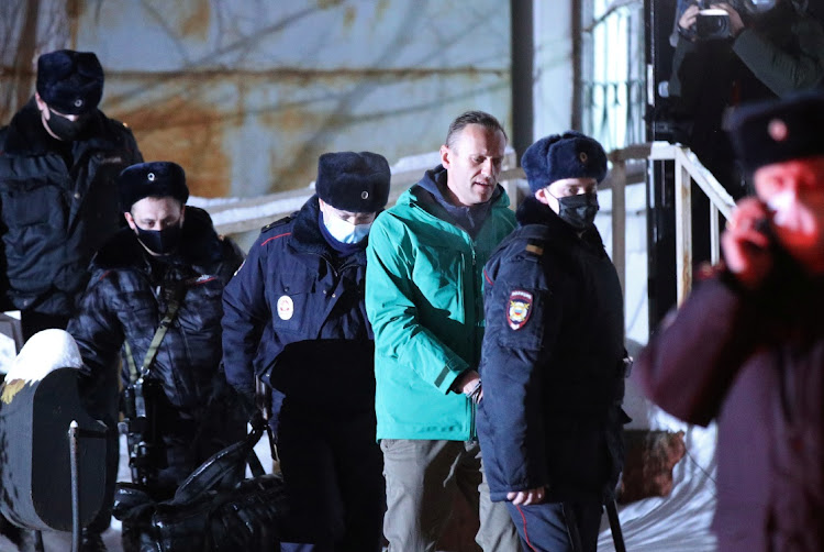 Russian opposition leader Alexei Navalny is escorted by police officers after a court hearing, in Khimki outside Moscow on January 18 2021. Picture: EVGENY FELDMAN/MEDUZA via REUTERS
