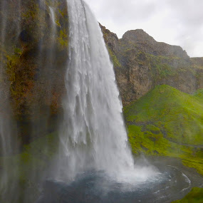 Underneath Seljalandsfoss by Santford Overton - Landscapes Waterscapes ( landscapes, sky, cloiuds, mountains, green, waterfalls, waterscapes, light, volcanoes, river, water, phoography )