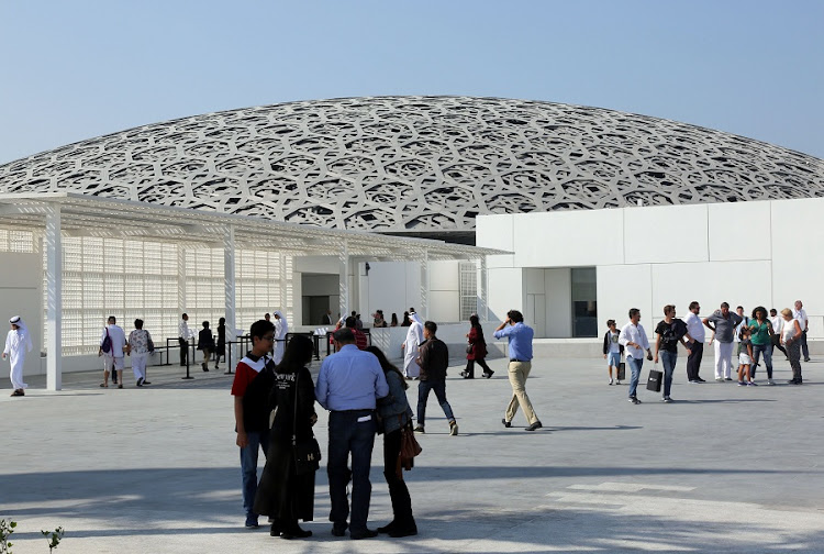Visitors are seen at the Louvre Abu Dhabi after it was opened to public in Abu Dhabi, United Arab Emirates. Picture: REUTERS/SATISH KUMAR