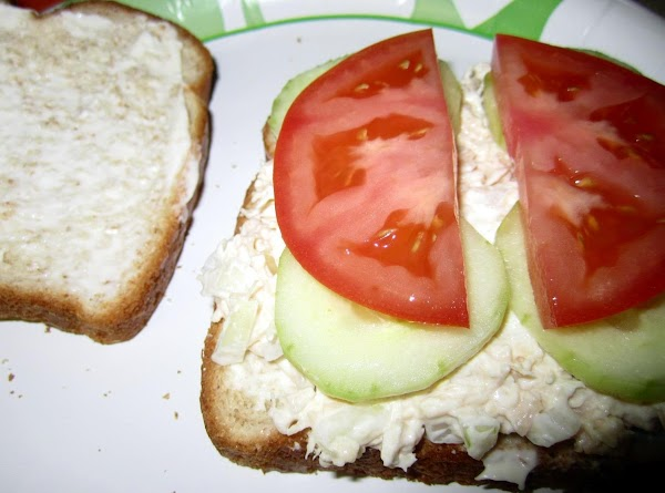 Lay 4 slices of bread down. (I spread a little mayo on the slices)...