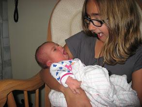 Photo: Kaitlyn holding Elizabeth, both yawning---sort of.