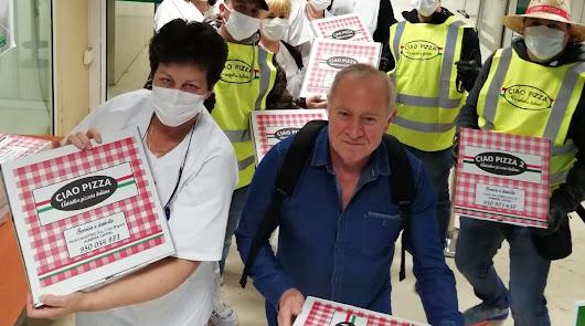 La solidaridad también se come: donan 150 pizzas para sanitarios y policías