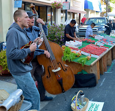 Photo: 22. There were a few local musicians playing, as well - here two blue grass performers are entertaining for change.