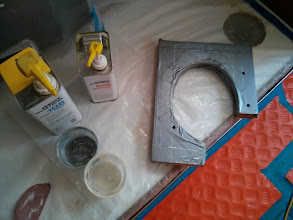 Photo: covering new mast collar backing plate in duct tape to prevent epoxy used for filling the deck voids from adhering