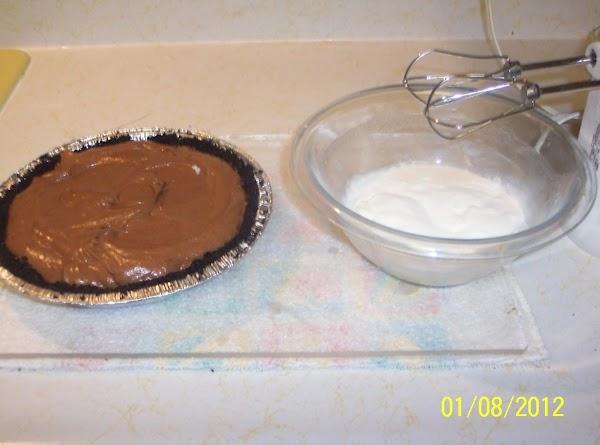 In a heavy saucepan, combine sugar,cornstarch,salt with a wire whisk stir in milk till...