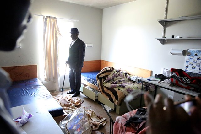 Minister of Police Bheki Cele inspecting the room where the student was stabbed to death by another student in University Of Zululand on September 18 2018