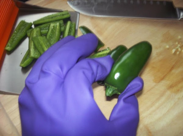 Wearing gloves, split hot peppers, remove seeds (or leave some in for more heat)...