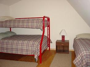 Photo: Cabin 4 upstairs bedroom.