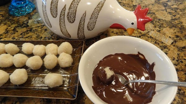 Then roll the balls in the melted chocolate.