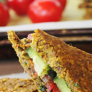 TOMATO CUCUMBER SANDWICH on ONION & CORN BREAD with OLIVE & KALE TAPENADE.