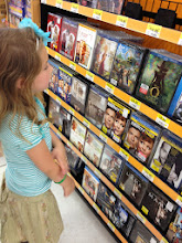 Photo: First stop in the store: checking out the DVDs. But we're here for a fun cheesy lunch so no DVD buying today.