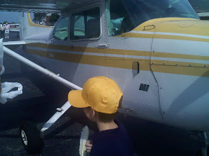 Photo: Getting on the plane to drop the feather