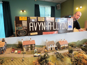 Photo: 010 Older narrow gauge modellers will no doubt remember Avyn-A-Llyin from its appearance in Railway Modeller all of 22 years ago in the February 1992 issue. The layout is still very much going strong and was brought along to this event by Andrew and brother David Bailey. David is trying hard to duck behind the nameboard in this snap .