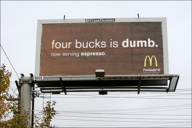 """McDonald's poster with the text """"Four bucks is dumb. now serving espresso."""""""