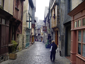 Photo: Madame strolling the medieval city center, with very little open, and so very quiet, on this Sunday afternoon.
