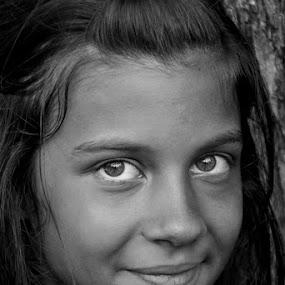 Striking Eyes by Elias Spiliotis - Babies & Children Child Portraits ( girl, little, smiling, portrait, black&white )