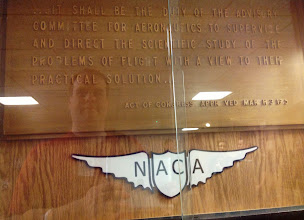 Photo: Reflective self-portrait via a display at Glenn Research Center. This is a 1940s plaque from the pre-NASA days of the National Advisory Committee for Aeronautics.