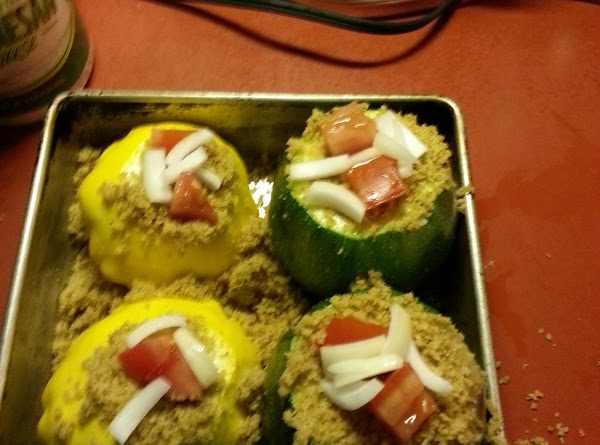 Place slices of onion in each zucchini half. Cover with bread crumb mixture and...