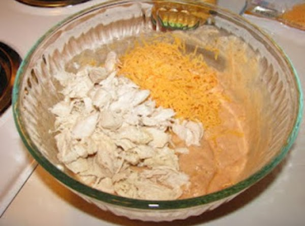 Stir 1 cup soup mixture, chicken, cooked rice and cheese in large bowl.