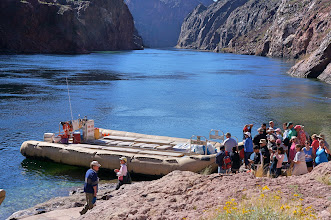 Photo: Preparing to board the raft, with a beautiful view of the Colorado River in the background.