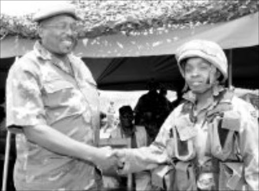 WELL DONE: Young paratrooper Mantoa Leburu is congratulated by Lieutenant-General Solly Shoke. Pic. Michael Tlhakudi. © Sowetan.