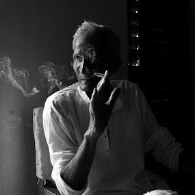 Behind the smoke by Victor Mukherjee - People Portraits of Men ( smole, cigarette, shadow, india, light, window-light )
