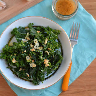 Massaged Kale Salad With Miso Ginger Dressing And Garlic Chips.