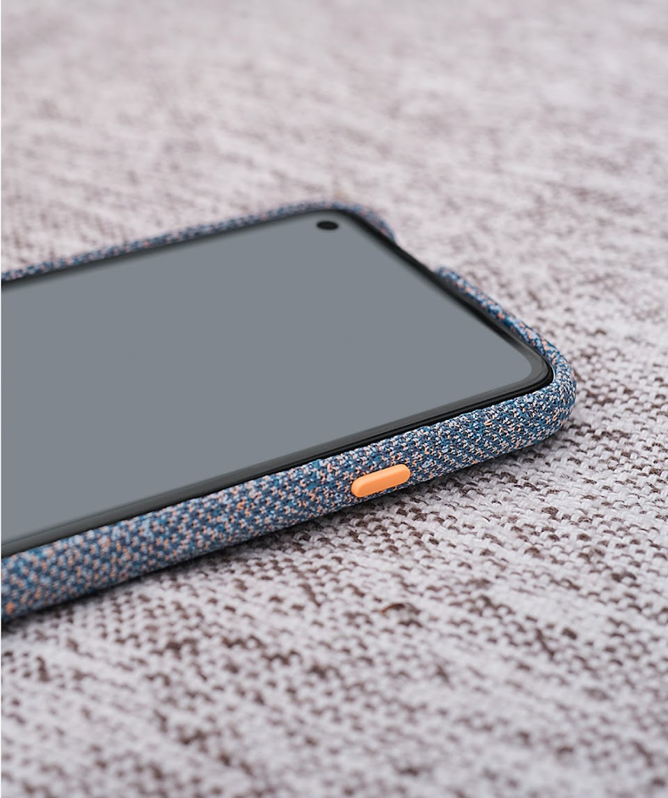 Angled close-up of blue Pixel 4a Case showing orange pop button.