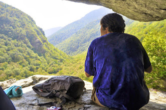 Photo: Taking in the view from a rock cave at Smugglers' Notch State Park