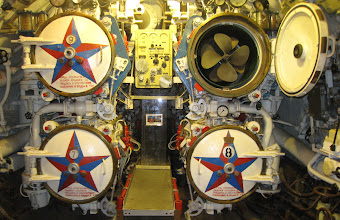 """Photo: The four aft nuclear torpedo launch tubes in the Soviet submarine """"Scorpion"""".  The other end of the submarine has six launch tubes."""