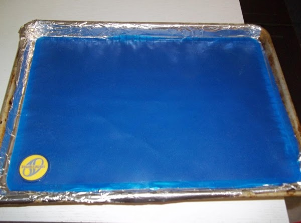 line your baking pan with parchment paper or a silicone baking sheet