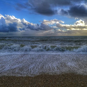 Yesterday morning down at the beach, whilst raining was capturing the sky and waves.clouds. by Sam Kirimli - Uncategorized All Uncategorized ( Photography, sea, waves, HUAWEI, low, shingle, beach, beauty )