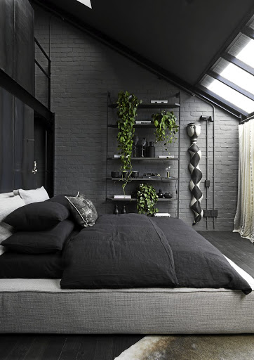 In the bedroom, double-volume ceilings and sliding doors that open onto a private balcony aid the sense of loftiness.