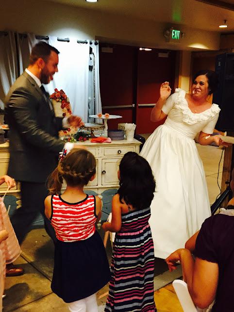 Smashing cake in face, wedding cake, country wedding