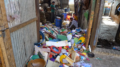 Photo: Plastics are first sorted into type and color, and then shredded before being sold.