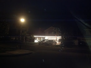 Photo: These people.  Every year they light up their house like a strip mall... compare the brightness of those bulbs to the streetlight.  It's blinding to drive by.