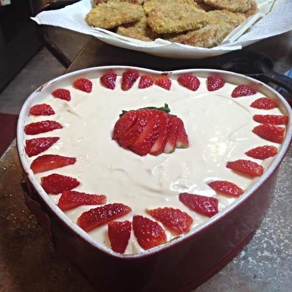 Garnish top of cheesecake with whole halved or quartered strawberries, I added a whole...