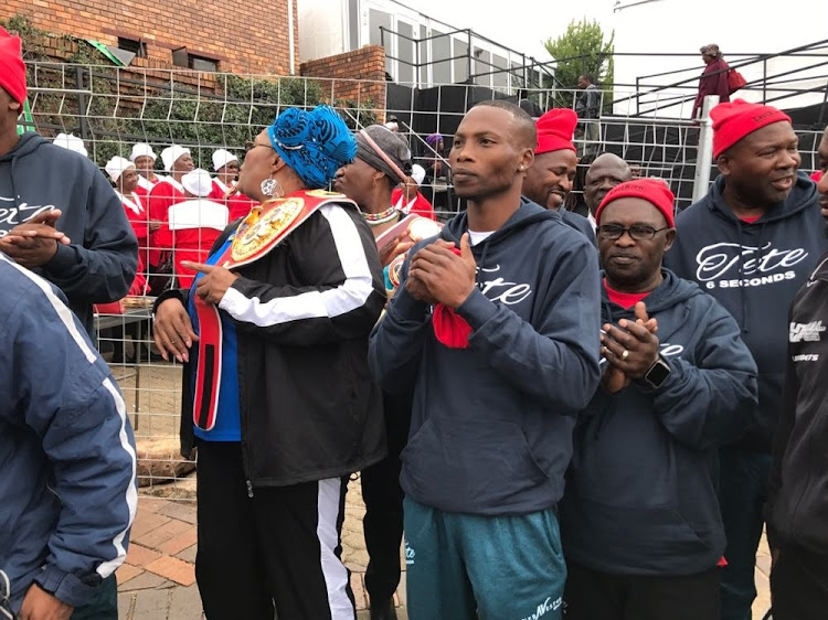 Zolani Tete, front row third from left, BSA chairman Peter Ngatane (in glasses) , MEC for Sport in the Eastern Cape Pemmy Majodina (between Ngatane and Tete) and other boxing members at the house of departed political stalwart Nomzamo Winnie Madikizela-Mandela in Soweto.