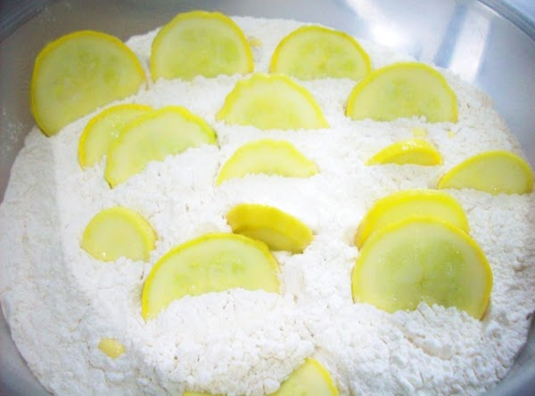 With flour in another bowl or using your batter pro, dredge in flour, making...