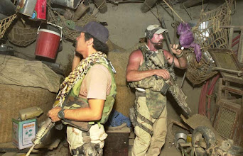 """Photo: Members of the U.S. Army ODA 924 Special Forces, right, """"Rob"""" and """"Walt,"""" search a storage shed of a compound suspected of being an al-Qaida safe house, Wednesday, Sept. 4, 2002, on the outskirts of Khost, 145 kms. (90 miles) southeast of the Afghanistan capital of Kabul. (AP Photo/Wally Santana)"""