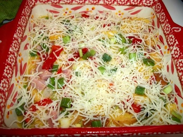 Pour into prepared baking dish. Top with remaining scallions, roasted red peppers and cheese.