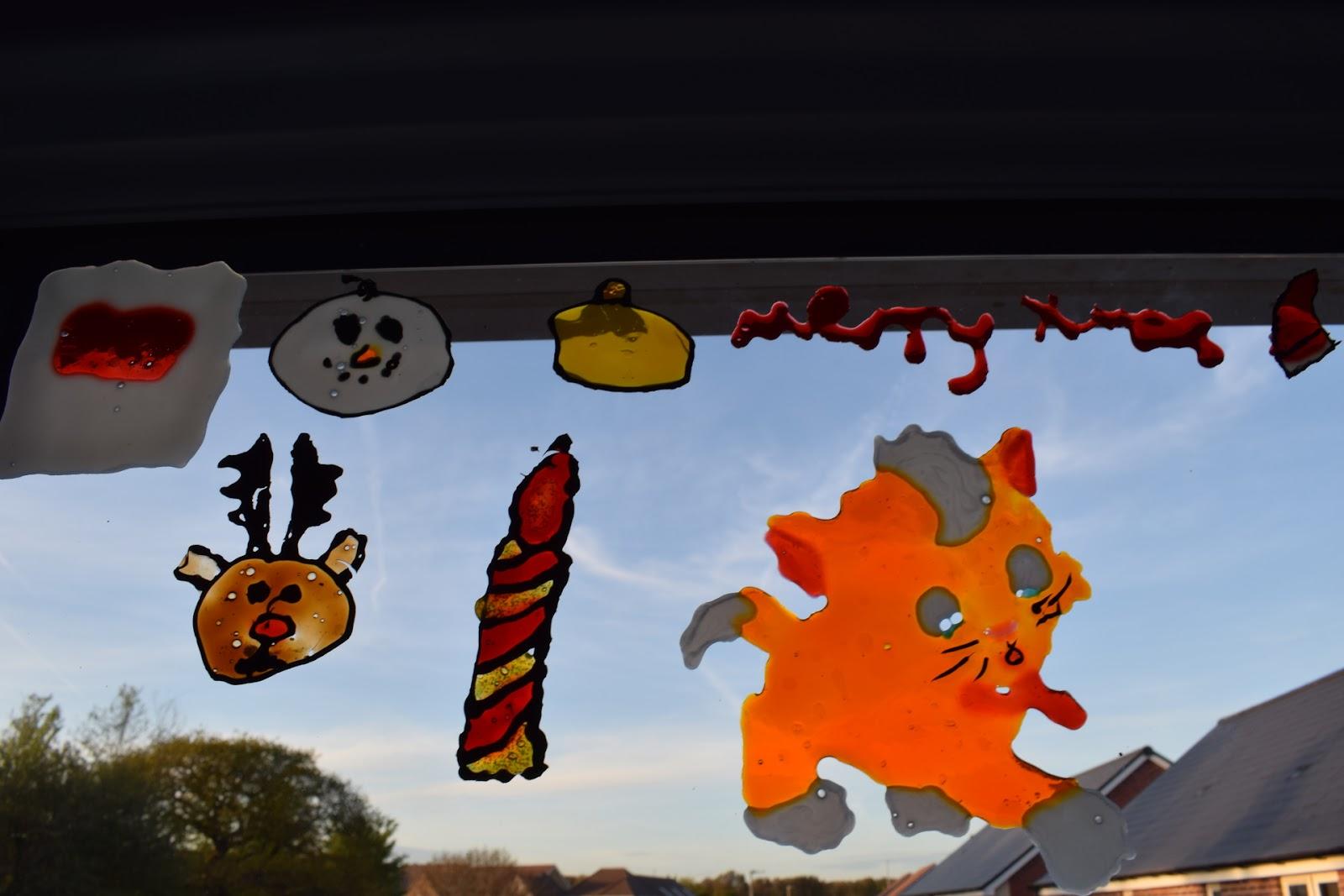"(<img alt=""kids Christmas craft ideas window stickers"">)"