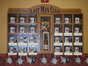 Photo: Gordon and Martha Fick, set up lunch for us at Glen's Bakery and Deli where of group of veterans known as the Last Man club, meet almost daily for lunch.  Originally there where 24 men in the group. There are 9 remaining. The last man, gets the bottle of Booker's Kentuckey bourbon, in the center of the display. Meeting us for lunch were Warren, Bob, and Jake.