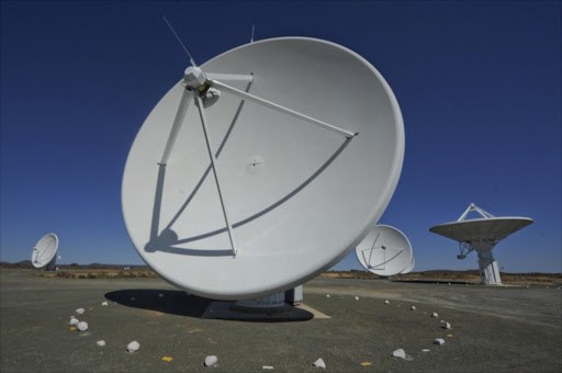 The satellite dishes that make up the SKA KAT radio telescope. Picture Credit: Gallo Images