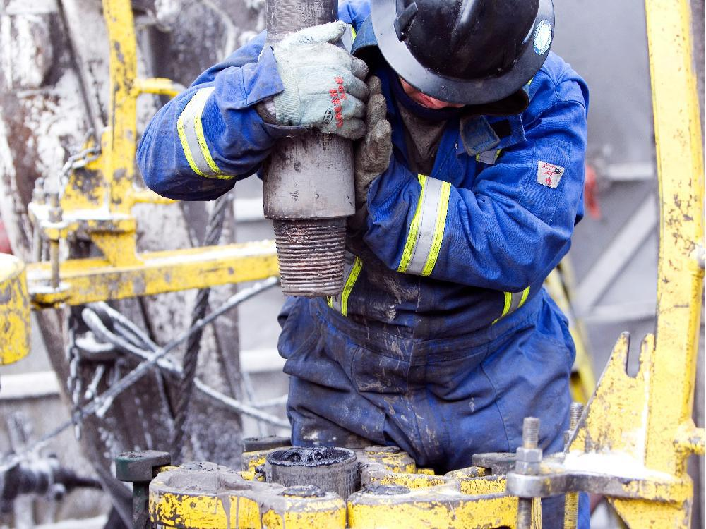 An Ensign roughneck works on a rig.
