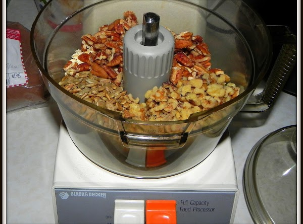 Grind sesame seeds, oats, walnuts, sunflower seeds and pecans in your food processor.