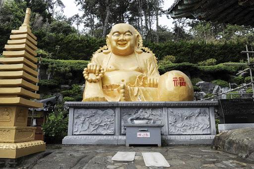 A laughing Buddha at the Haedong Yonggungsa Temple in Busan, South Korea.